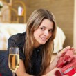 Young woman at home with present - Stock Photo