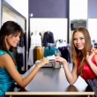 Young woman in a shop buying clothes — Stock Photo #5157103