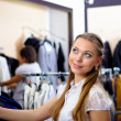 Young woman in a shop buying clothes — Stock Photo #5157152