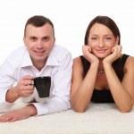 Couple at home holding a mug — Stock Photo