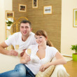 Couple at home drinking champagne — Stock Photo