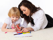 Mother and little daughter on the floor — Stock Photo