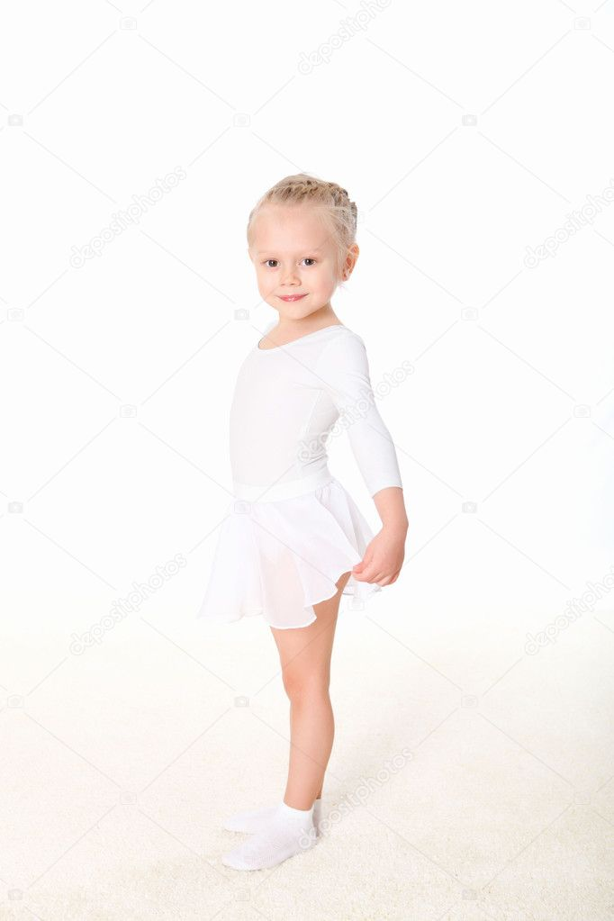 Little girl doing gymnastics against white background  Stock Photo #5157230