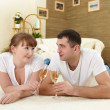 Couple at home drinking champagne — Stock Photo #5163528