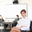 Young business woman in office — Stock Photo #5163590