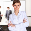 A young business woman in office — Stock Photo #5167236