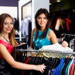 Young woman in a shop buying clothes — Stock Photo #5167273