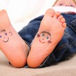 Small faces painted on soles — Stock Photo #5167324