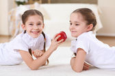 Twin sisters together at home — Stock Photo