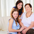 Three generations of women together - Foto Stock