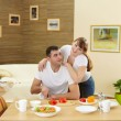 Husband and wife at home in the kitchen — Stock Photo #5173618