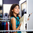Young womin shop buying clothes — Stock Photo #5173647