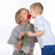 Mother and son holding a red rose — Stock Photo