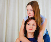 A young teenage daughter with a mother — Stock Photo