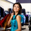 Young woman in a shop buying clothes — Stock Photo #5183207