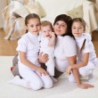 A young mother with her three daughters at home — Stock Photo #5183777