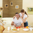Husband and wife at home in the kitchen — Stock Photo