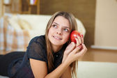 Young woman with present at home — Stock Photo