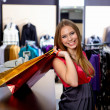 Young woman in a shop buying clothes — Stock Photo #5197267
