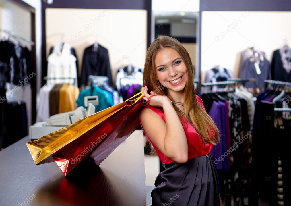Young girl in a shop buying clothes — Stock Photo #5197632