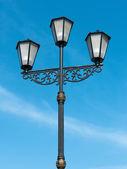 Street lamp against the blue sky — Stock Photo