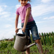 Stock Photo: Little girl with watering can
