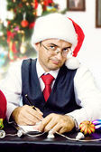 Business man as Santa at Christmas and New Year holidays — Stock Photo