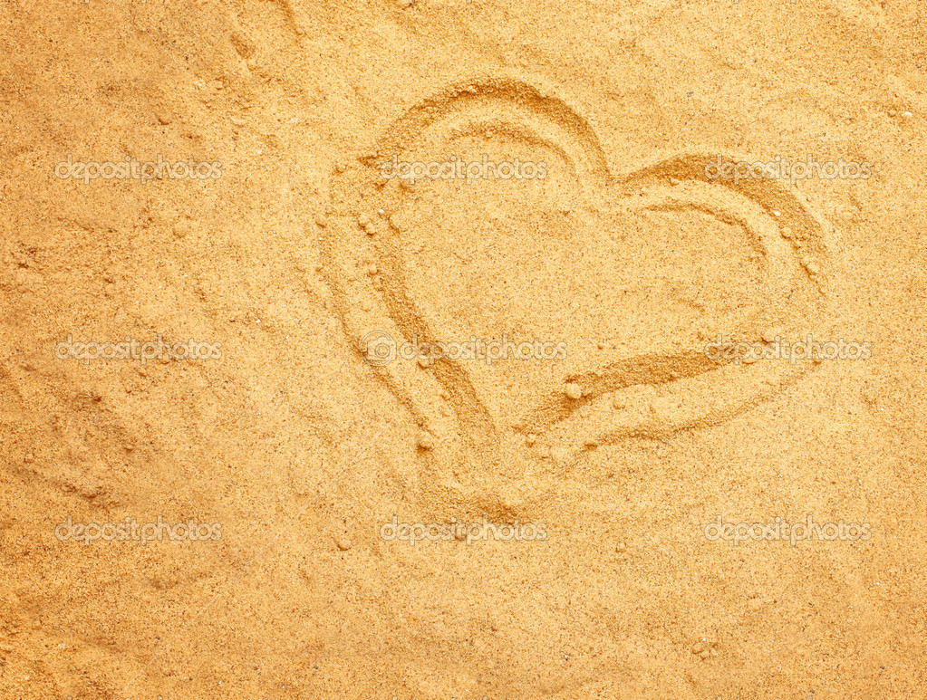 Valentine background. Heart on the sand  Stock Photo #2997675