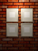 Picture frames on a brick wall — Stock Photo