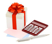 Gift and calculator — Stock Photo