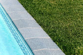Border between pool and a lawn — Stock Photo