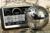 Car navigator on the old map. — Stock Photo