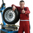 Royalty-Free Stock Photo: Handsome  young car mechanic with wheel