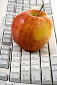 Red apple on keyboard — Stock Photo