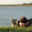 Dreaming man on the river bank — Stock Photo #3603530