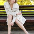 Foto Stock: Sexual girl in coat