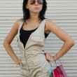 Стоковое фото: Brunette in spectacles with package