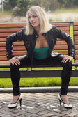 Blonde girl in black jacket — Stok fotoğraf