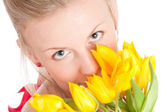 Young woman with bunch of tulips — Stock Photo