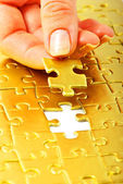 Gold puzzle — Stock Photo