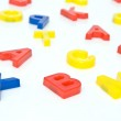Colorful plastic letters — Stock Photo
