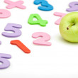 Numbers and apple - Stock Photo