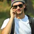 Man smiling and talking on a mobile phone — Foto de Stock