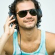 Foto Stock: Portrait of young man with headphones