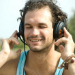 Stock Photo: Young mlistening to music