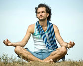 Young man in yoga position — Stock Photo