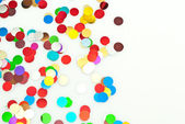 Close up of confetti on white background — Stock Photo