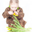 Photo: Little girl with flowers