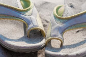Flip-flops and sand — Stock Photo