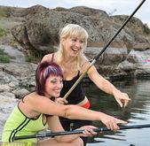 Girls on the lake — Stock Photo